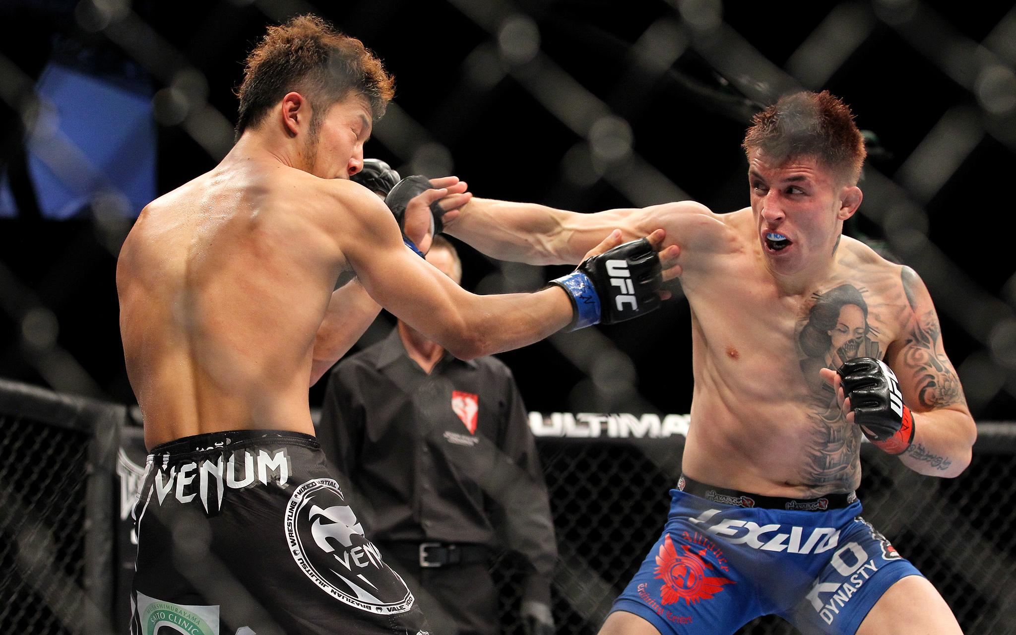 Norman Parke punches Kazuki Tokudome