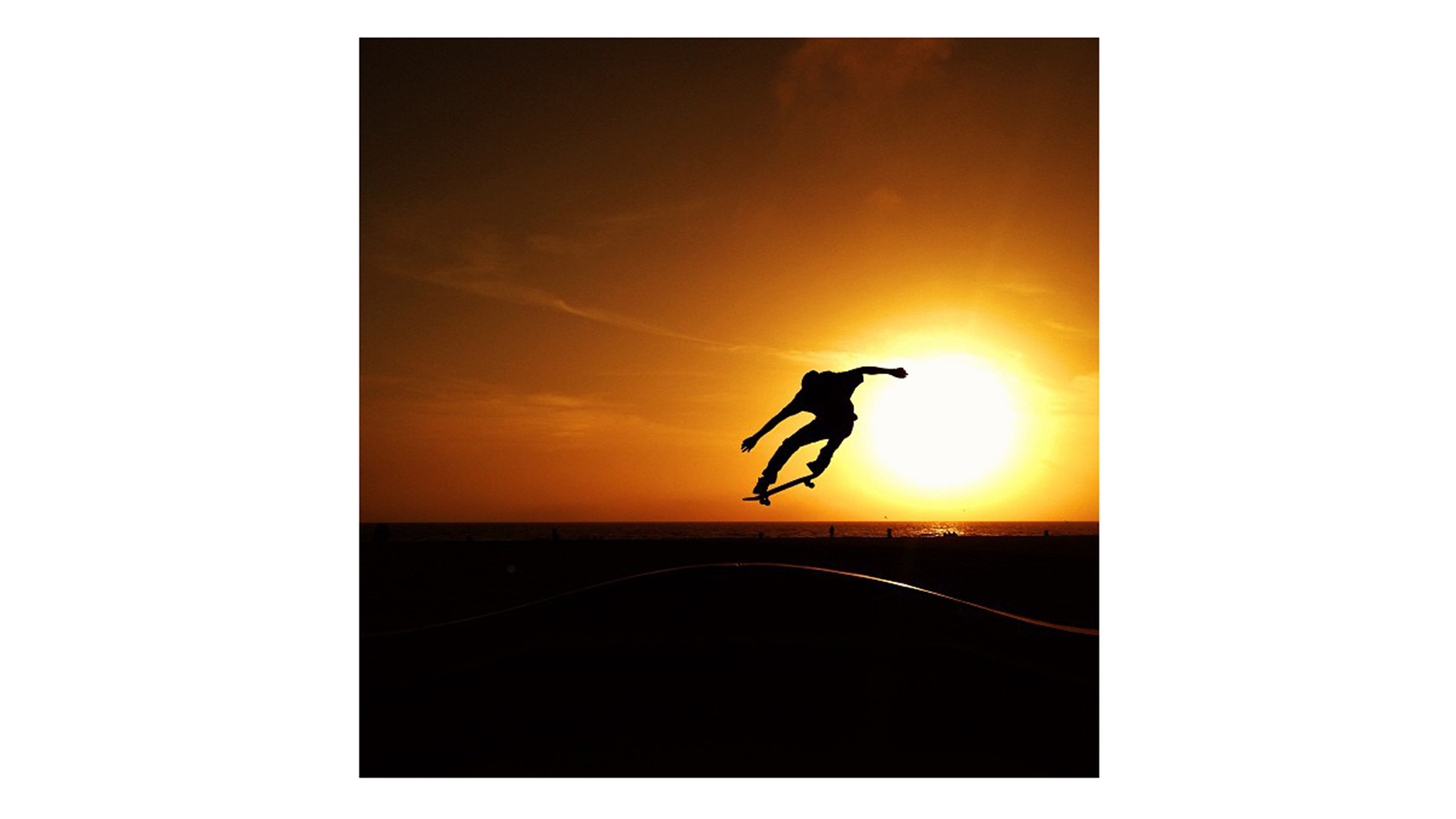 This image is very reductive, with only the silhouette, but it has that kind of feel of 'Endless Summer.' Just a kid and his skateboard. But very strong -- the silhouette is very interesting profile. -- Alex Hillinger