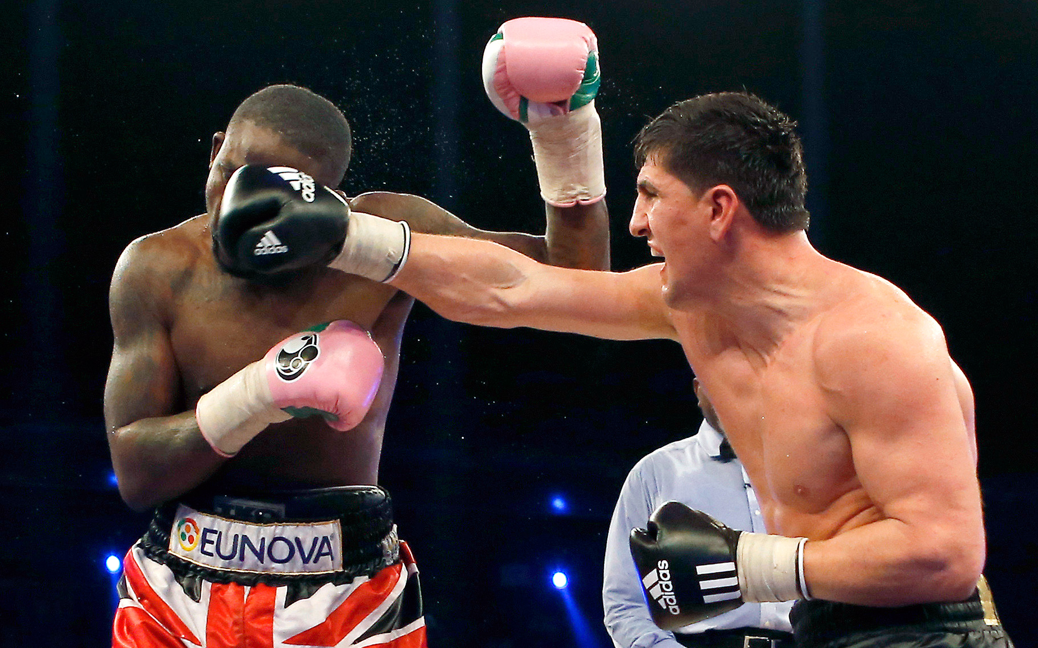Marco Huck lands a punch to Ola Afolabi