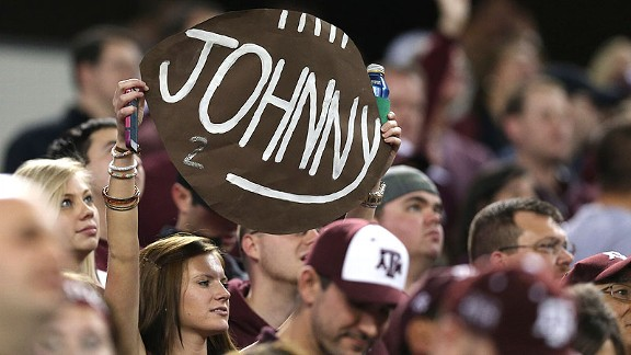 Texas A&M fans showing their love for Johnny Manziel at a game. They do the same at cash registers.