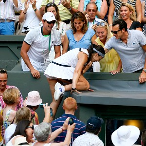 Marion Bartoli needed a hand to reach her friends and family after winning her first Wimbledon championship.