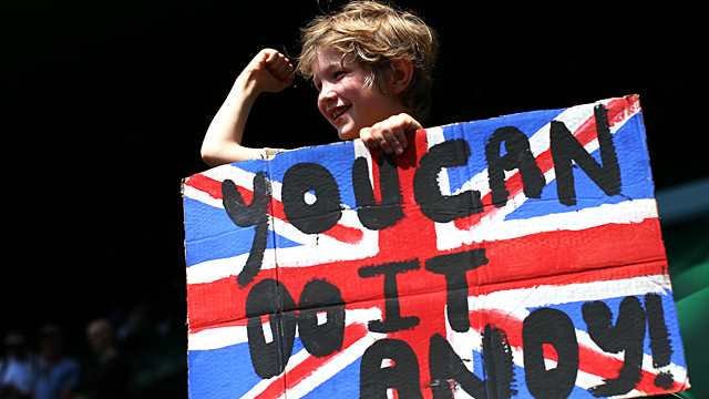 A young tennis fan holds a Union Jack banner with a message of support for Andy Murray of Great Britain