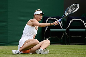 Maria Sharapova was one of many players slipping and sliding on the lush lawns, but to her credit, she finished her match.