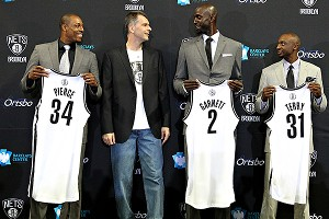 Paul Pierce, Mikhail Prokhorov, Kevin Garnett and Jason Terry.