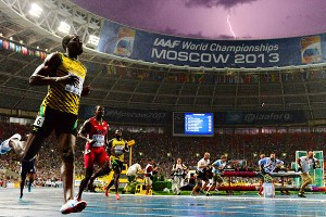 Usain Bolt regained the 100-meter world championship title he lost through a false start two years ago.