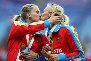Russian runners Tatyana Firova and Kseniya Ryzhova say their kiss was just celebration, not a political statement.