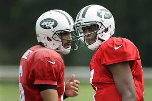 Mark Sanchez and Geno Smith are locked in a head-to-head quarterback battle.