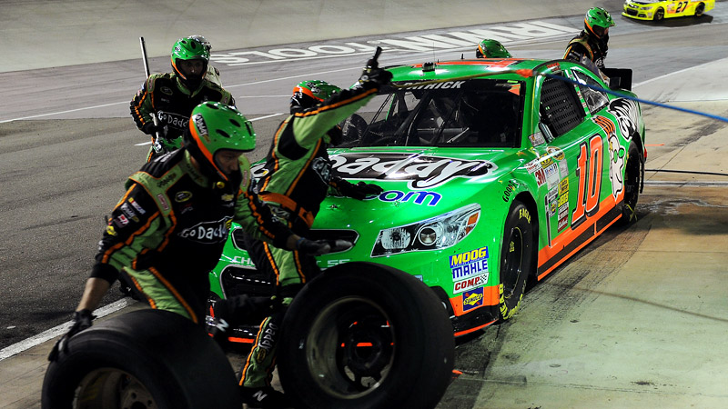 Danica Patrick's crew hustles in the pits during Saturday night's race in Bristol, Tenn.