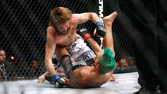 MILWAUKEE, WI - AUGUST 31:  Tim Elliott (white shorts) and Louis Gaudinot (black shorts) battle during their featherweight bout at UFC 164 at the BMO Harris Bradley Center on Saturday, August 31, 2012 in Milwaukee, Wisc. Elliott won by a unanimous decisio