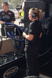 Sarah Fisher decided the best way to help the team was by spending race day in Lucas Luhr's pit.