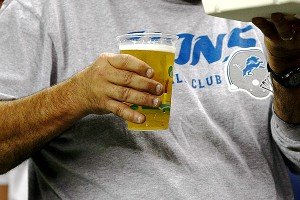 Lions fan with a beer