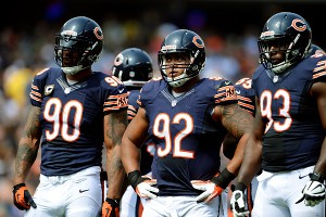 Julius Peppers, Stephen Paea and Nate Collins