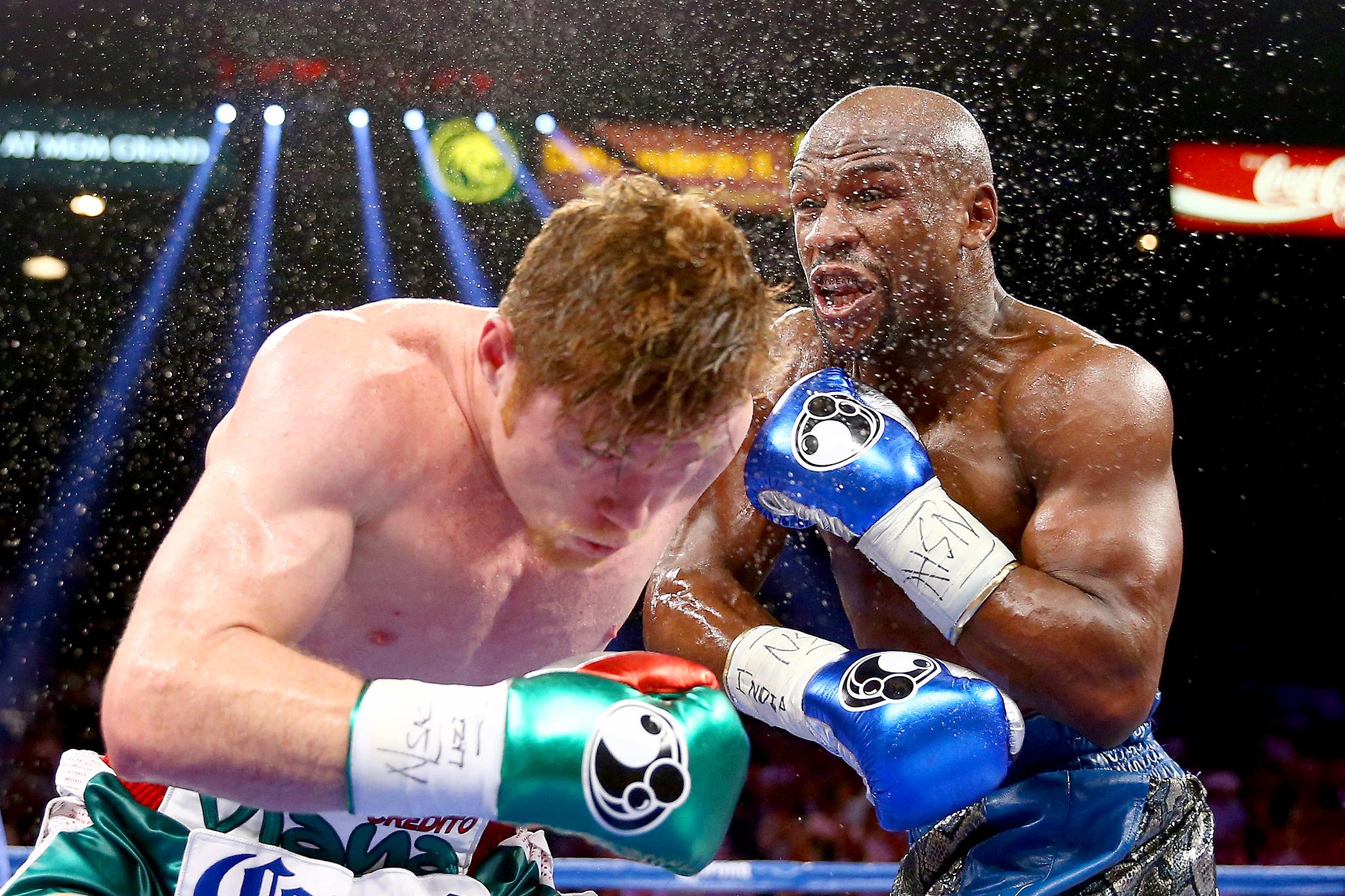 Canelo Alvarez and Floyd Mayweather Jr. exchange punches