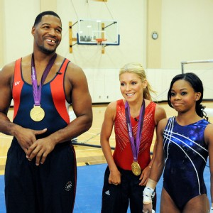 Michael Strahan donned spandex for a workout with Gabby Douglas on Live! With Kelly and Michael.