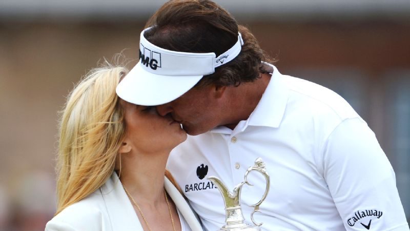 Having to choose just one picture of Phil Mickelson kissing his wife Amy in celebration is like asking us to pick a favorite puppy. There are just so many to pick from.  Heres a recent example as the two rejoice in Leftys 2013 Open Championship victory.