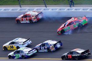 Danica Patrick wobbled on the first turn of the race Sunday, then crashed and collected two cars.