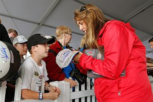 Johanna Long takes some time out to sign autographs at Kentucky Speedway.