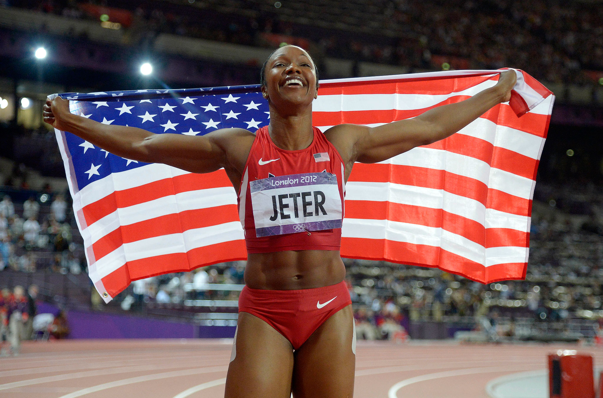 Carmelita Jeter celebrates after winning the bronze medal in the 200 meters at the London Olympics. At 32 years old, Jeter took home a gold, silver and bronze from the London Games.