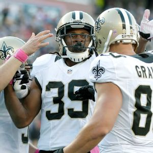 Drew Brees, Travaris Cadet and Jimmy Graham