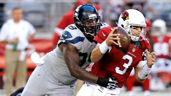 Tony McDaniel and Carson Palmer