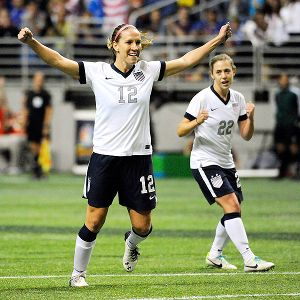 Lauren Holiday, left, opened the scoring for the U.S. with a goal in the sixth minute Sunday.