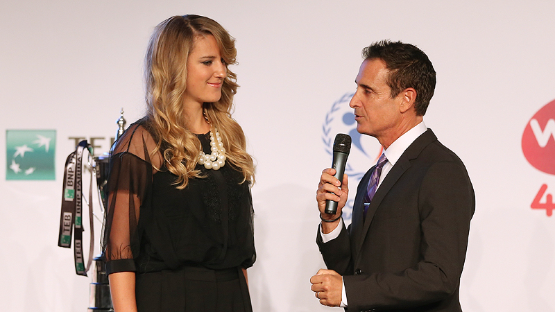 Victoria Azarenka takes the stage for an interview with the master of ceremonies. Guessing he didnt ask her to do the Party Rock dance.