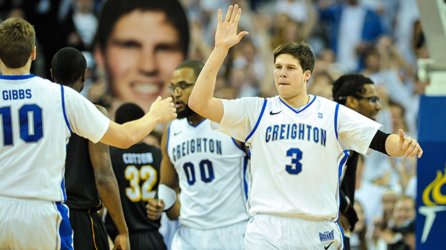 Doug McDermott #3 of the Creighton Bluejays high fives teammate Grant Gibbs #10 during their game at the CenturyLink Center on March 2, 2013 in Omaha, Nebraska.