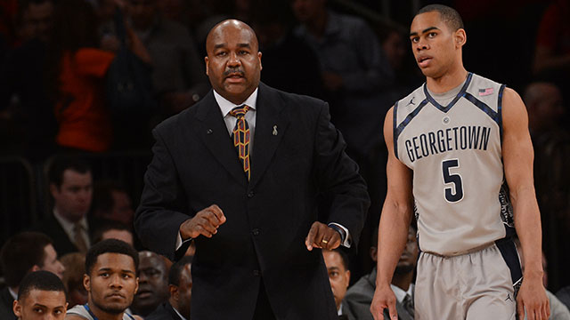 Georgetown Hoyas head coach John Thompson III talks with Georgetown Hoyas guard Markel Starks (5) during the first half of their Semifinal Round game of the Big East Championship at Madison Square Garden on Friday, March 15, 2013.