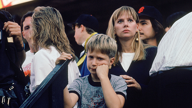A young dejected baseball fan