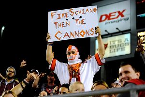 A Buccaneers fan holds up a