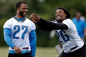 Louis Delmas and Glover Quin