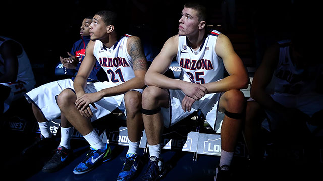 Brandon Ashley #21 and Kaleb Tarczewski #35 of the Arizona Wildcats sit on the bench during introductions to the college basketball game against the Northern Arizona Lumberjacks at McKale Center on November 28, 2012 in Tucson, Arizona.