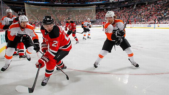Claude Giroux #28 of the Philadelphia Flyers and Andrei Loktionov #21 of the New Jersey Devils