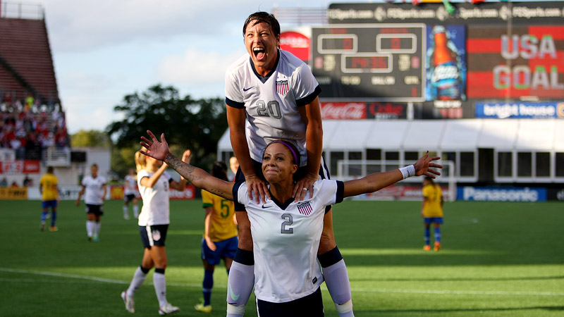 USWNT's Sydney Leroux (2) and Abby Wambach (20) celebrate after Leroux scored the first goal of the game against Brazil. Wambach also scored in the first half.