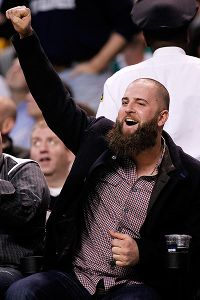 Nov 13, 2013; Boston, MA, USA;  Boston Red Sox first baseman Mike Napoli reacts during the fourth quarter of the game between the Boston Celtics and the Charlotte Bobcats at TD Garden.  The Charlotte Bobcats won 89-83.