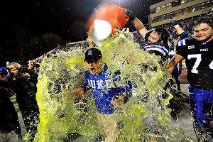 Duke and David Cutcliffe celebrate after beating Miami