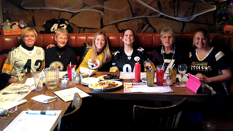 Alyssa Roenigk, third from left, catches up with friends and family to find out why Pittsburgh women love their hometown Steelers.