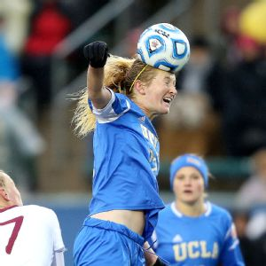UCLA's Sam Mewis puts some force behind a header during Sunday's championship game. Despite the cold, damp day, Mewis donned short sleeves throughout the match.