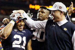 Auburn's Tre Mason and Gus Malzahn celebrate
