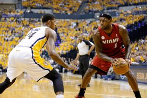 LeBron James (6) drives the ball against Indiana Pacers forward Paul George