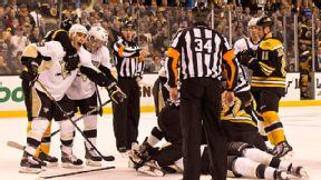 Penguins' Pascal Dupuis (#9) and teammate Jayson Megna