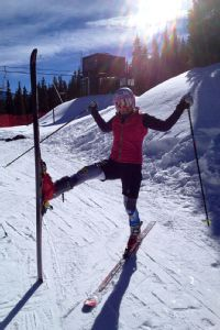 Alice McKennis celebrates her first time wearing downhill skis post-surgery.