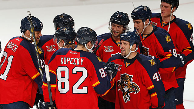 Mike Weaver #43 congratulates Tomas Kopecky #82 of the Florida Panthers