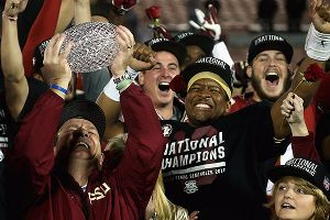 Jimbo Fisher and Jameis Winston celebrate Florida State's BCS Championship win