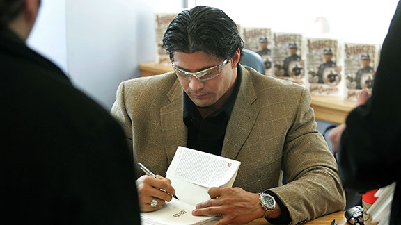 Former MLB player Jose Canseco signs copies of his best-seller book 'Juiced' March 18, 2005 at Borders Books in Chicago, Illinois. Canseco's controversial book references the use of anabolic steroids in Major League Baseball. Death threats to Canseco made