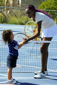 Venus, pictured here, and Serena Williams have traveled throughout the world, including Nigeria and Jamaica in 2013, to help bring the game of tennis to others.