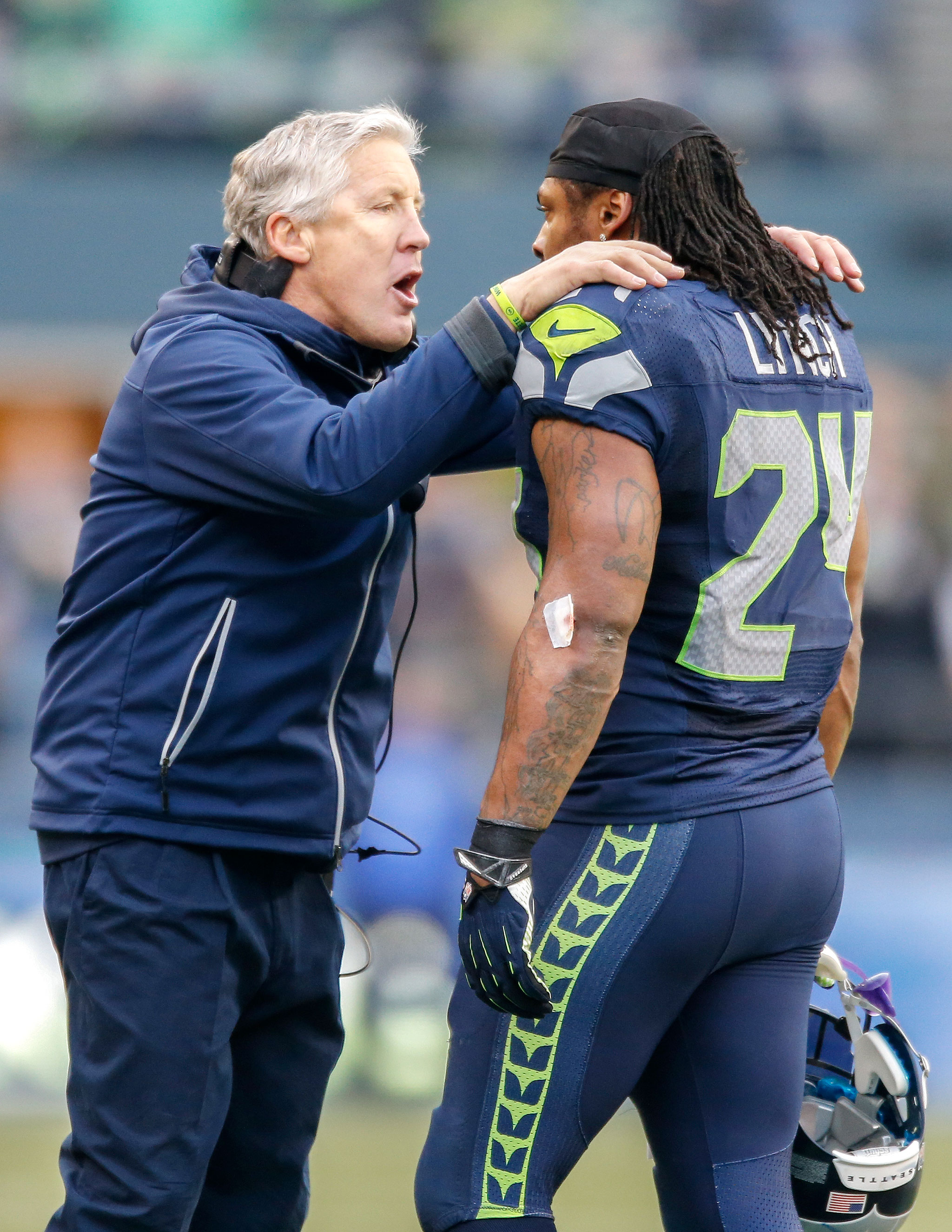 SEATTLE, WA - DECEMBER 29:  Head coach Pete Carroll of the Seattle Seahawks talks with running back Marshawn Lynch #24 during the game against the St. Louis Rams at CenturyLink Field on December 29, 2013 in Seattle, Washington.