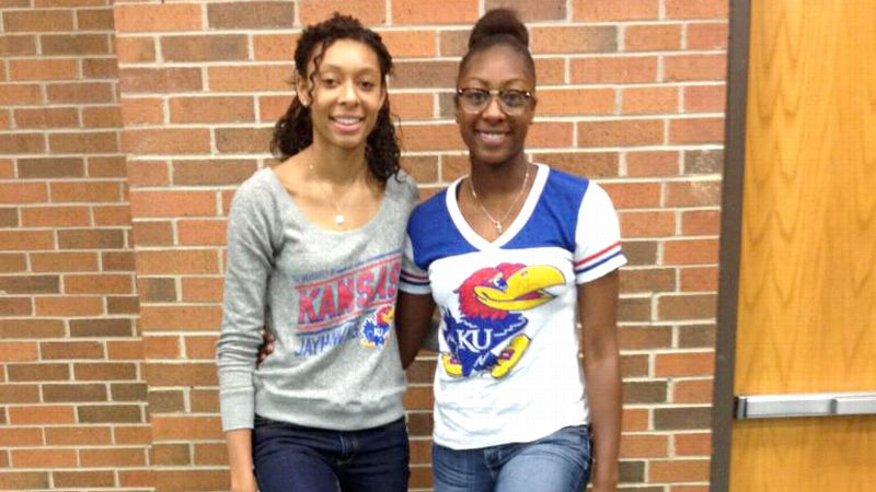 Kayla Cheadle, left, plans to be a hit on the Kansas volleyball team while Chayla looks to hit jumpers on the Jayhawks basketball team.