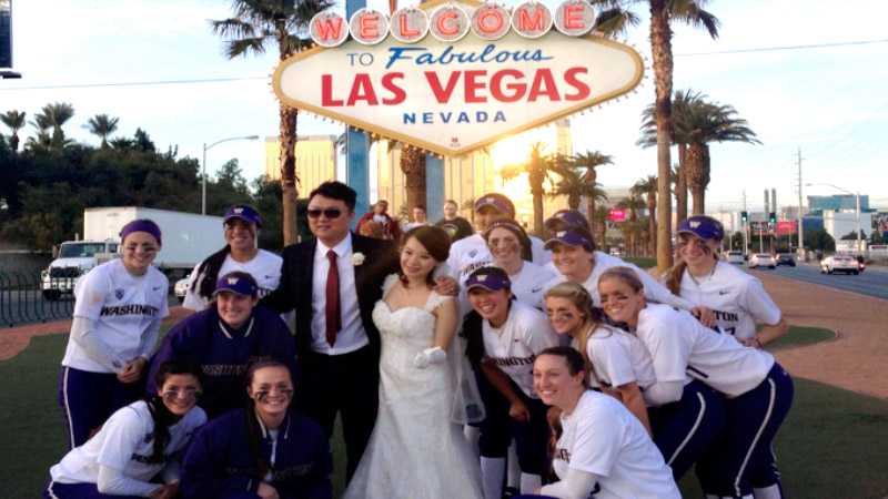 Only in Vegas: A newlywed couple asked the softball team to take its picture with them.