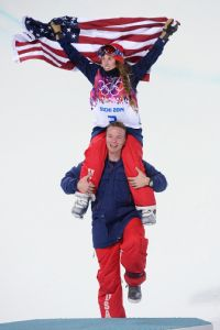 Ski halfpipe gold medalist Maddie Bowman gets a lift to the podium from American teammate David Wise, who won the men's event.